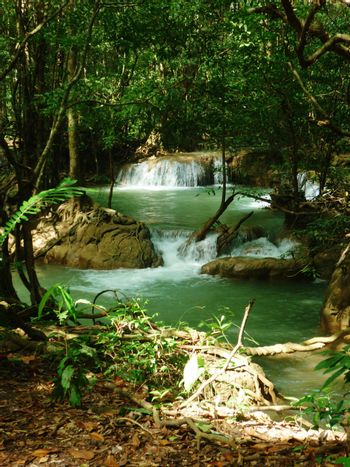 a fresh water river in thailands jungle. perfect place for a nice romantic picnic.