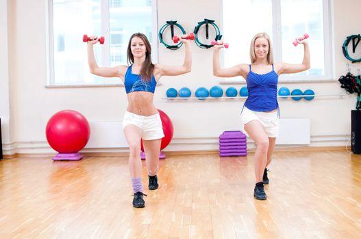 Women do stretching exercise