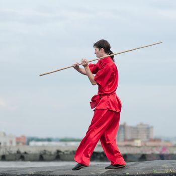 Wushoo man in red practice martial art