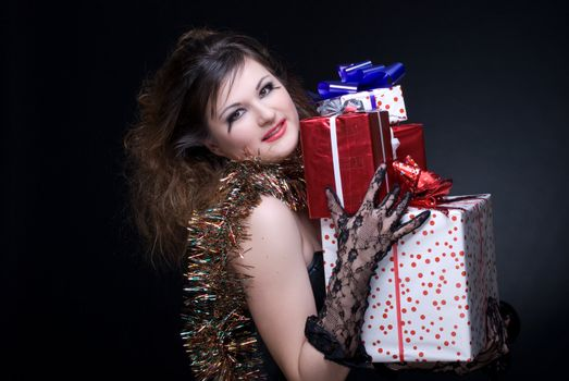 Closeup portrait of girl with red lips, tinsel and present on bl