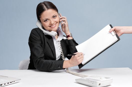 Busy business woman talking by phone