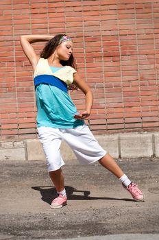 Beautiful teenage girl dancing hip-hop