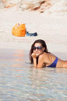 sexy beautiful model laying on vacation. having fun on shore
