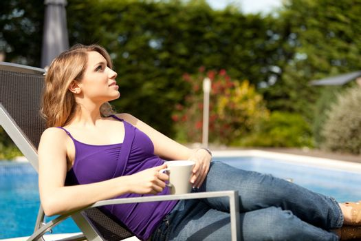 young beautiful woman drinking coffee or tea