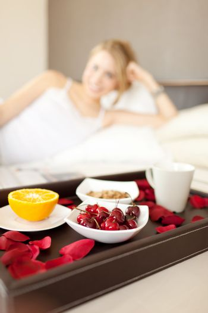 cherries detail in a women breakfast on bed