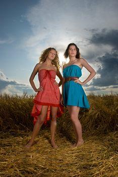 Two beautiful slavonic girls in wheat field