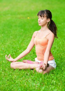 Teenage girl doing yoga exercise