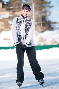 Ice skating. Woman skating on ice