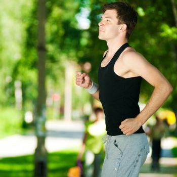 Young man jogging in park