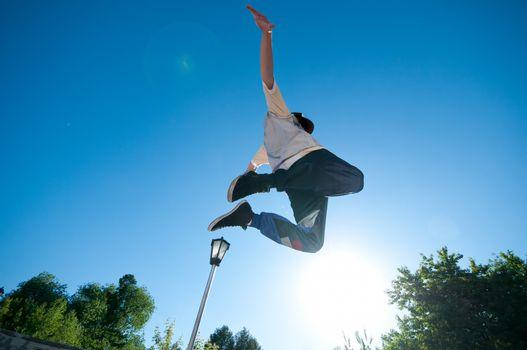 Men jump over blue sky