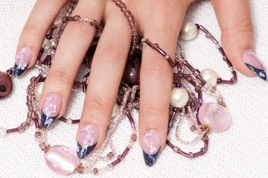 Closeup hands nail art with jewel