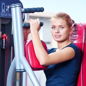 Woman at the gym exercising