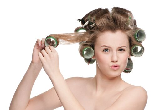 woman curling her hair with roller