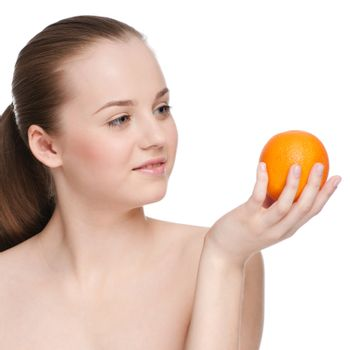 Young woman eat green apple and orange