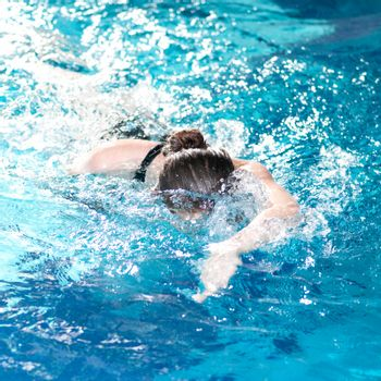 Swimmer woman performing the crawl stroke
