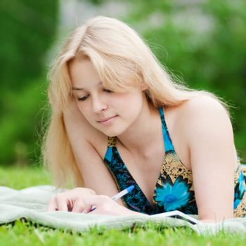 Beautiful young woman read book