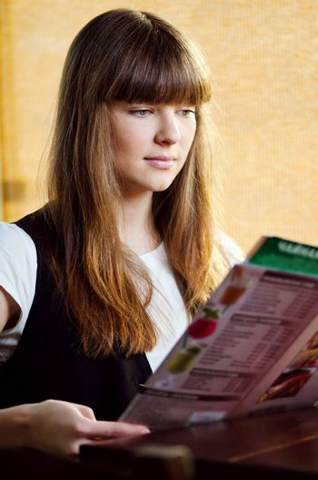 A young woman in a cafe