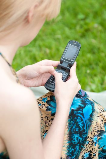 Woman texting on mobile phone
