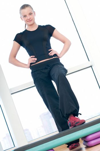 Young woman doing aerobic exercises