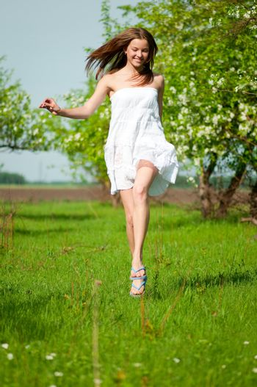 Beautiful young woman in apple tree garden