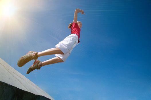 Beautiful woman jump into sky