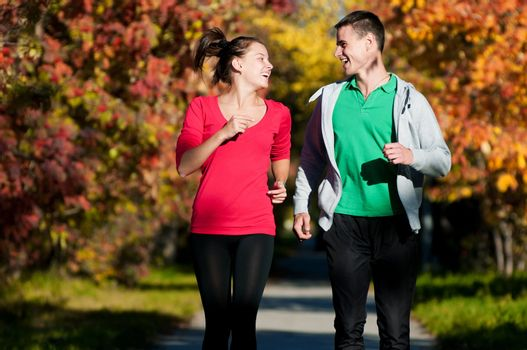 Young man and woman running