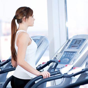 Young woman at the run at gym