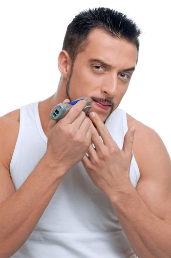 Young handsome man shaving