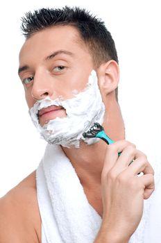 Portrait of man that shaving with foam