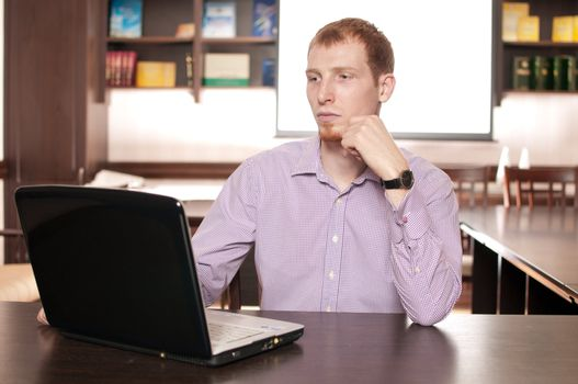 Emotional businessman with laptop