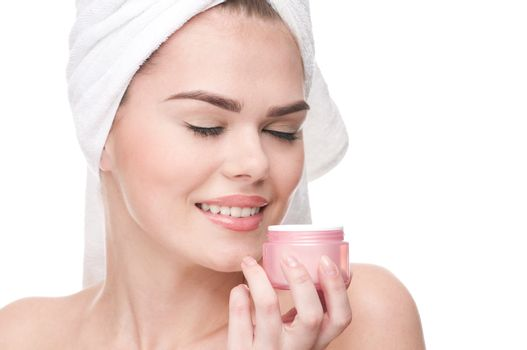Close-up of beautiful woman smell cream.