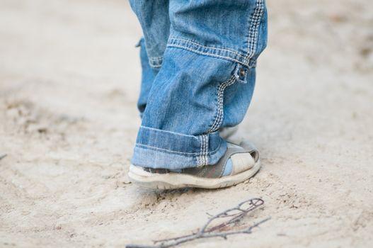 Closeup on a kids feet wearing grey sandals