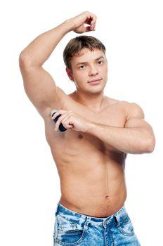 Muscular man's using an antiperspirant