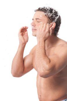 Young man wash face