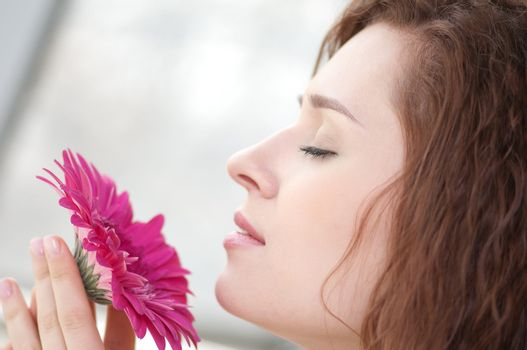 Happy woman with flower at dating
