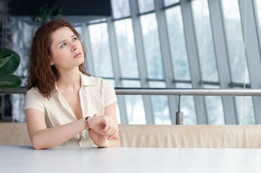 Business woman with watch at office