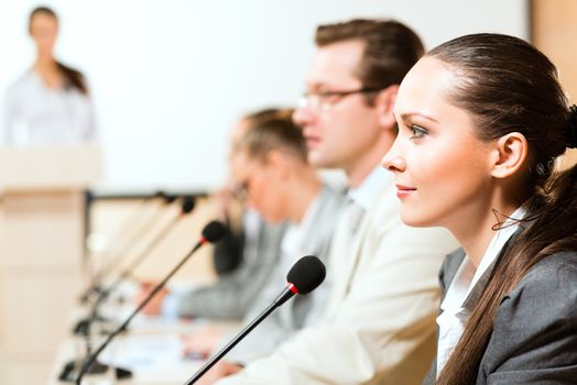 businessmen communicate at the conference