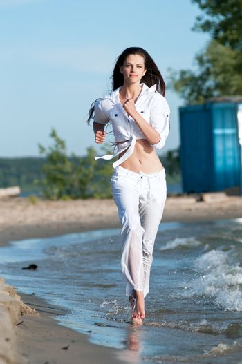 Sporty woman running on water