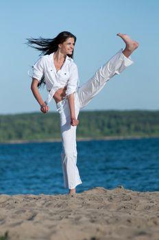 Athletic woman performing a kick
