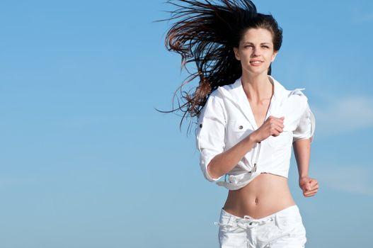Sporty woman running in sea coast