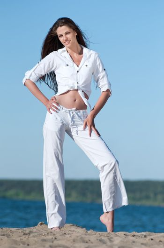 Sexy woman posing on the beach