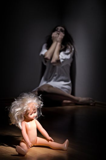 Zombie girl with doll