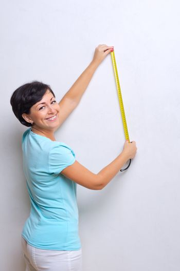 Woman with measurement tape