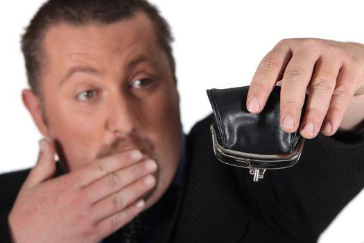 Man holding empty purse