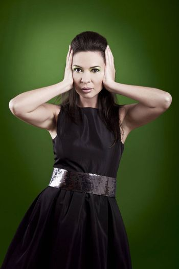 fashion woman posing over a green background