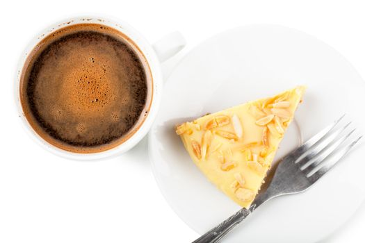 Top view of cup of coffee and pie on a white plate