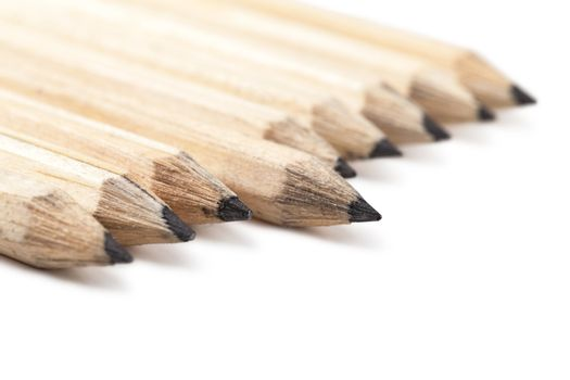 Macro view of group of lead pencils over white background