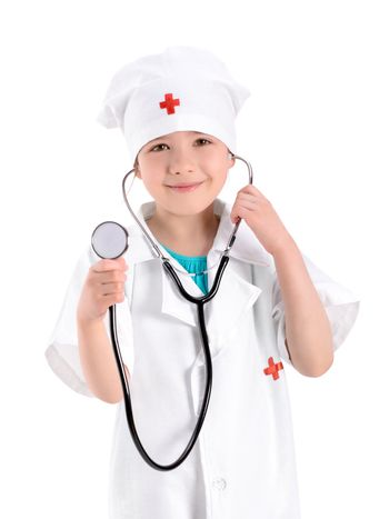 Portrait of a smiling little girl wearing as a nurse on white uniform and holding a stethoscope in hand. Isolated on white background.