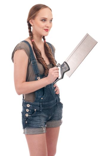 Young playful woman holding hand saw