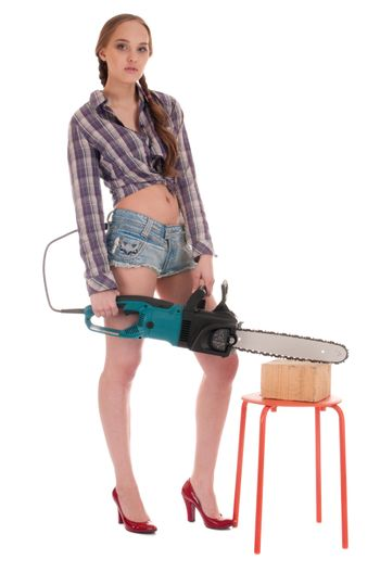 Young worker woman in jeans coverall with chain saw